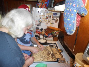 My mom and Kim trying to shell seeds.